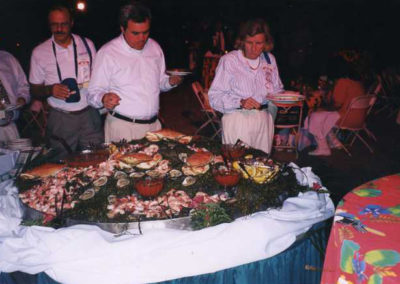 people taking food from buffet in evening